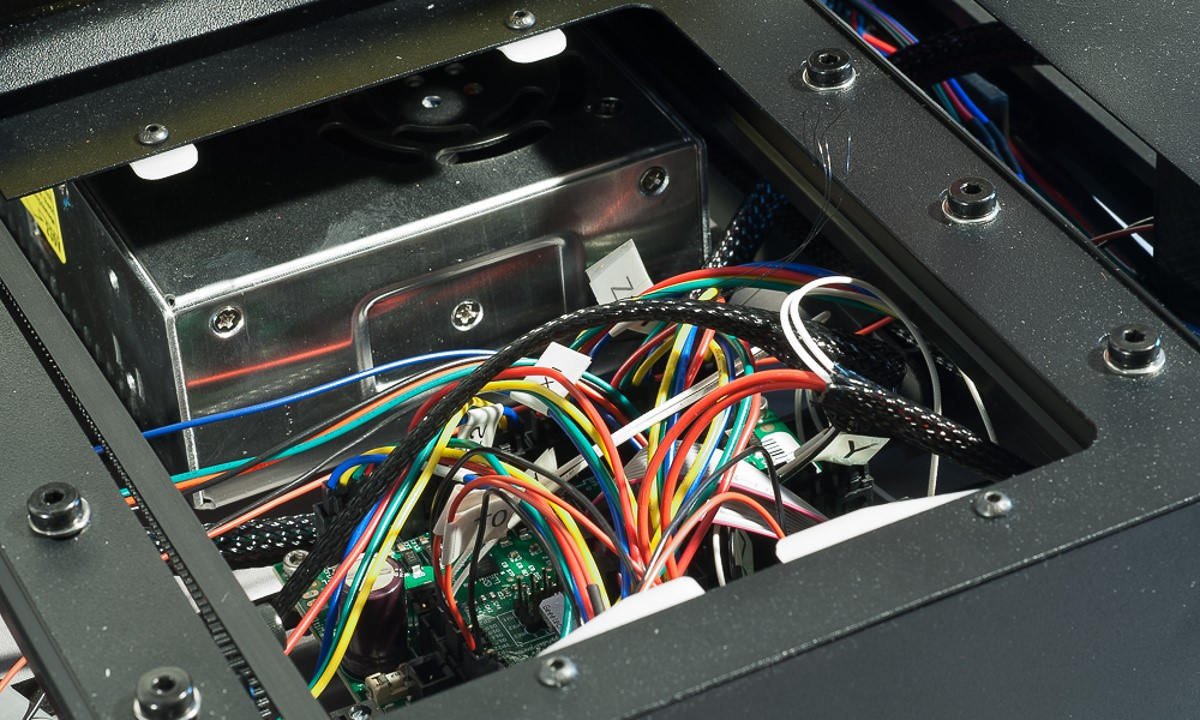The MendelMax 3 3D printer - Closeup of the electronics panel at the base of the printer showing the mass of connections
