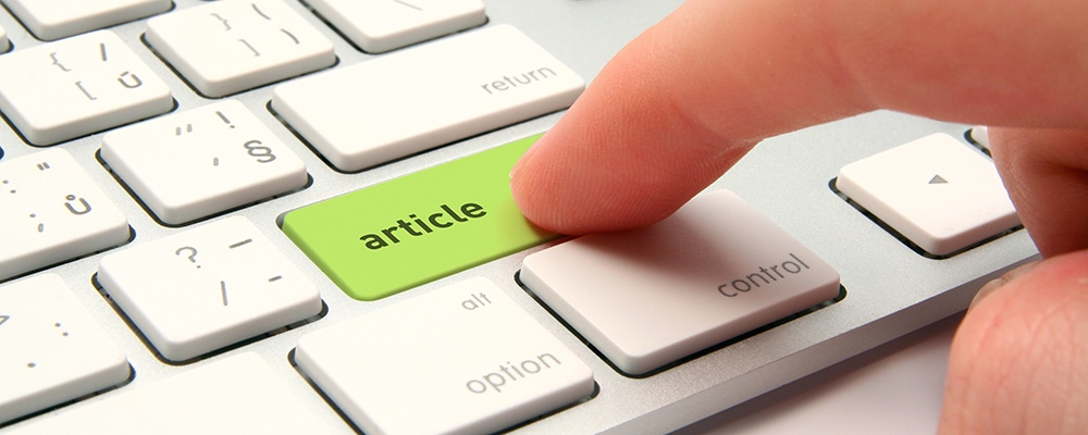 Articles - Mac keyboard with one key dedicated to 'article'