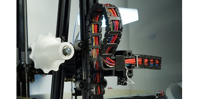 The MendelMax 3 3D printer - The cable chain on the left side of the printer showing its connection to the X axis