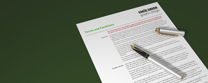 Terms and Conditions - image showing closeup of contract with hand holding a pen